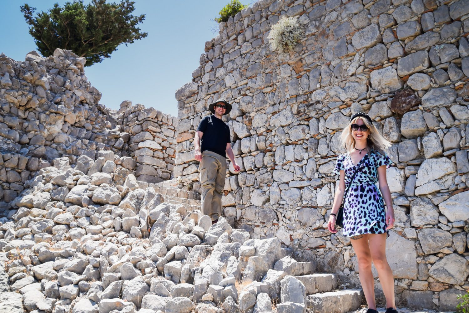 climbing at monolithos castle during private island tour