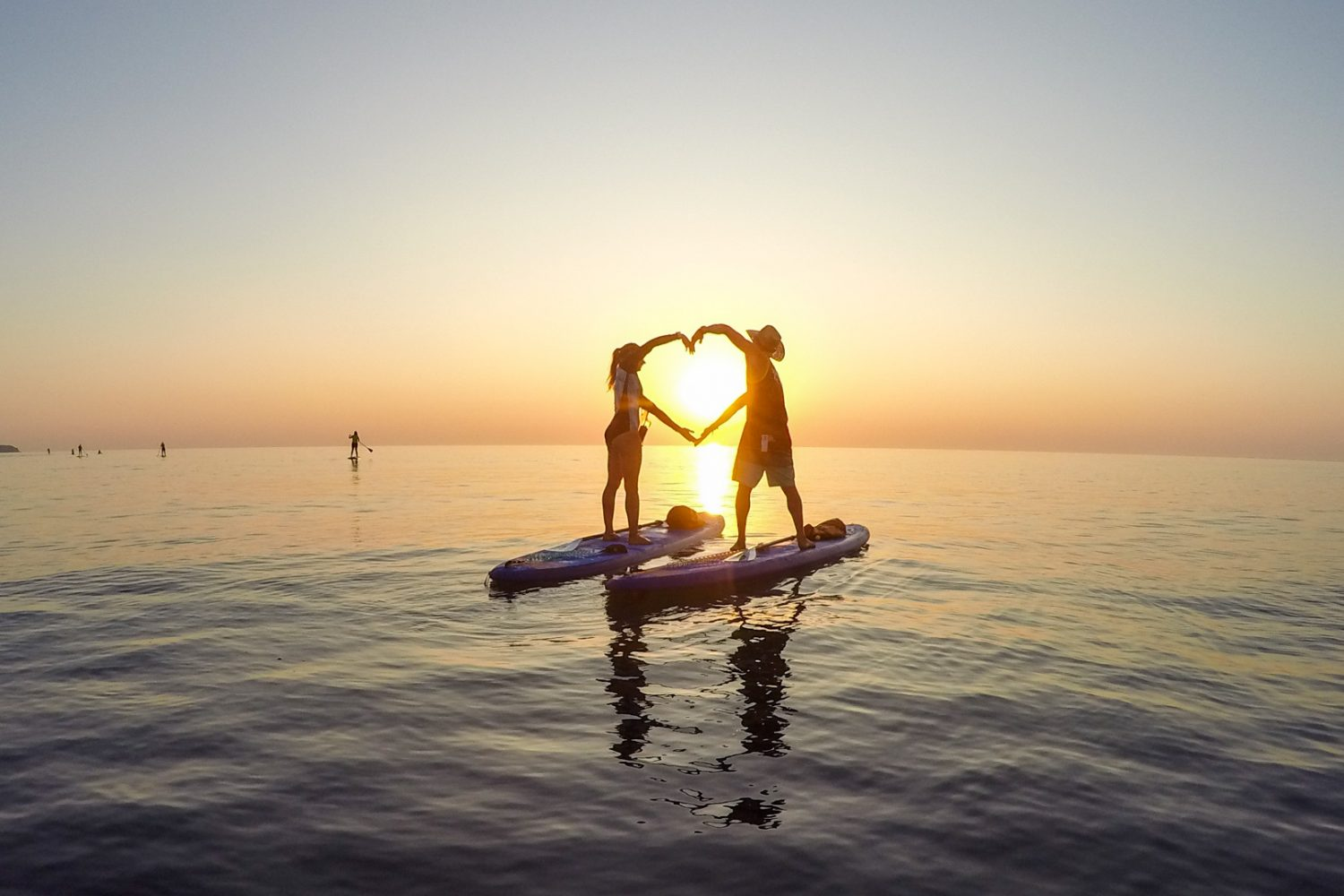 Stand Up Paddle boarding in sunset